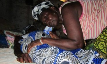 A traditional birth attendant treating a pregnant client