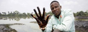 epa03556207 A undated image showing plaintiff Nigerian farmer Eric Dooh showing his hand covered with oil from a creek near Goi, Ogoniland, Nigeria. According to a report of UNEP (United Nations Environment Programme), leaks in Shell pipelines in Nigeria occur regularly, causing harm to communities in the Niger Delta region. A group of Nigerian plaintiffs claim Shell is liable for the damage the leaks caused, while Shell claims most leaks are the result of sabotage. Reports also state fishponds and farmland have been destroyed, while most locals have no other option but to drink from polluted water. Eric Dooh from Goi (Ogoniland), Alali Efanga from Oruma (Bayelsa) and Friday Alfred Akpan from Ikot Ada Udo (Akwa Ibom), individual farmers from three different communities in the Niger Delta, have taken Shell into the Dutch civil court of The Hague in a landmark pollution case, asking for compensation for damages to their land. The verdict in the case is due 30 January 2013. EPA/MARTEN VAN DIJL +++(c) dpa - Bildfunk+++