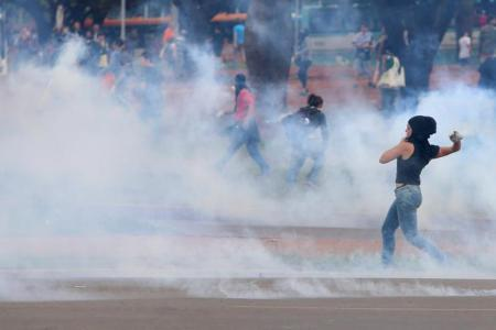 Anti-government demonstrators clash with riot-policemen during a protest against the constitutional amendment PEC 55, which limits public spending, in front of Brazil's National Congress in Brasilia